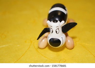 wooden cow on yellow background