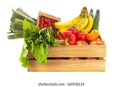 Wooden crate fresh vegetables and fruit isolated over white background