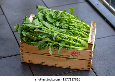 A wooden crate full of freshly harvested rapini (cime di rapa).