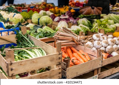 Wooden crates of carrots, garlic and other fruit and veg at Campo de Fiori, Rome