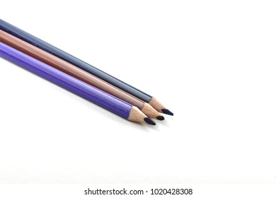 wooden crayons on a white background