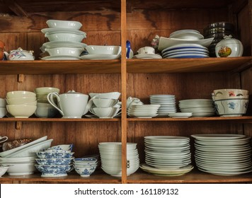 Wooden crockery in the pantry in the kitchen.