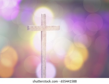 wooden cross with bokeh background, copy space