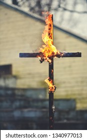The wooden cross is burning