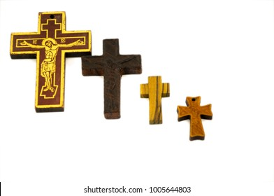 Wooden cross isolated on a white background. Concept for faith, spirituality and religion.