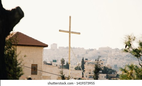 Wooden cross with Jerusalem housing in the distance