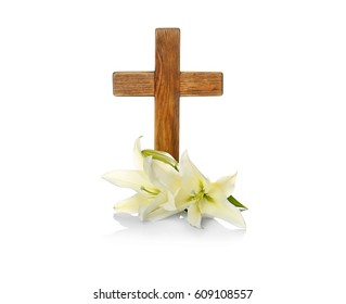 Wooden cross and lily on white background