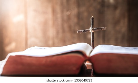 wooden cross in middle of the bible. christian concept.