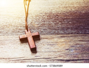 wooden cross  on on wooden background with copy space
