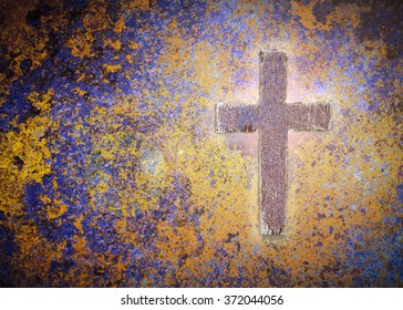 Wooden cross on rusty metal background with light effected, Christian concept