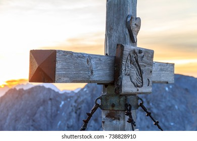Wooden cross on the top of a mountain