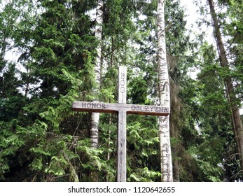"""Wooden Cross in Poland with Writing """"God, Honor, Homeland"""" in Nowinka, Poland, June 2018"""