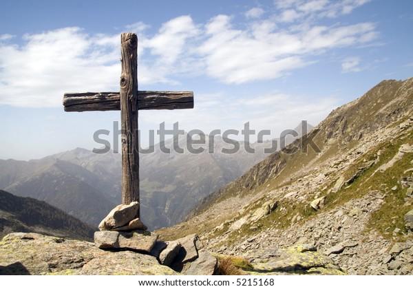 Wooden cross standing in italian Alps