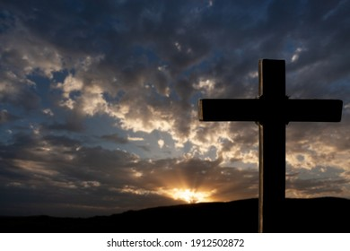 Wooden cross at sunset, crucifixion of Jesus Christ