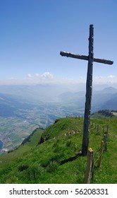 A wooden cross in the Swiss Alps