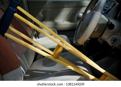 The wooden crutch leaning for walking training after a leg injury. The crutch leaning in the car. Inconvenience to drivers who use a crutch.