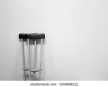 Wooden crutches Walking aids that used when you have injury about orthopedic. With black and white background