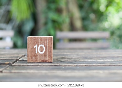 Wooden Cube. Block of wooden with numbers ten on natural background.