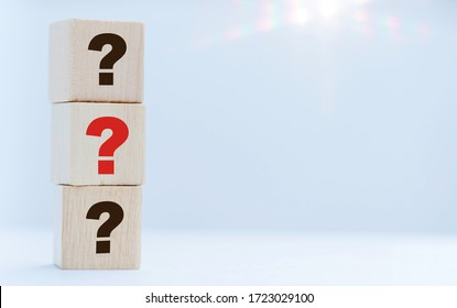Wooden cube block shape with sign question mark and Covid-19 coronavirus symbol on table.FAQ( frequency asked questions), Answer, Q&A, Information, Communication, Fake news, People and lockdown crisis