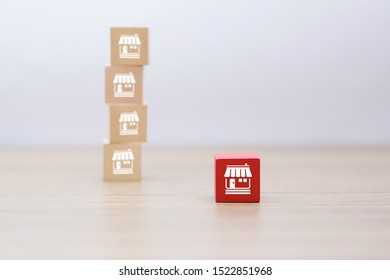 Wooden cube Stacked with Franchise business marketing icons Store for business growth concept.