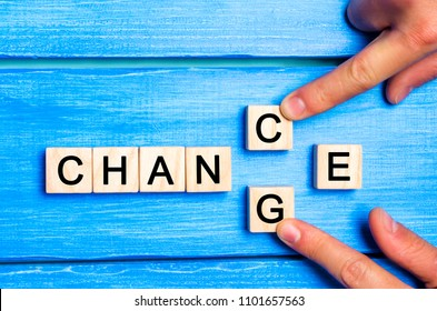 """Wooden cube with word """"change"""" to """"chance"""" on wood table. Personal development and career growth or change yourself concept. concept of motivation, goal achievement, potential, incentive, overcoming"""