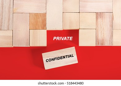 Wooden cube with a word PRIVATE CONFIDENTIAL