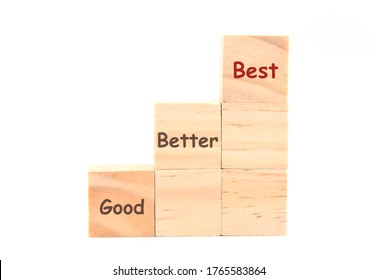 Wooden cubes arranged as staircase with word Good Better Best, on white background