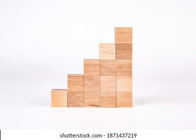 Wooden cubes in the form of stairs on a white background. Career climb.