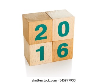 Wooden cubes isolated on white with a clipping path. New year, Christmas or January concept.