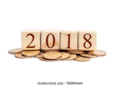 Wooden cubes with numbers 2018 on heap of coins.