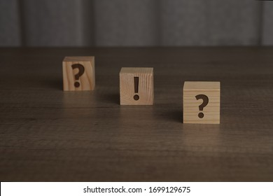 Wooden cubes with a question and exclamation mark on them. Can be used as concept