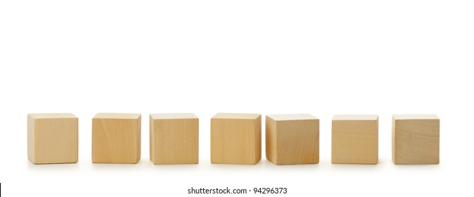 Wooden cubes in row. It is isolated on a white background