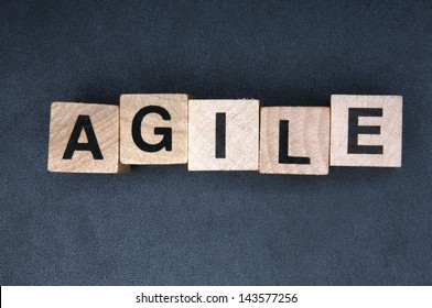 Wooden cubes spelling agile