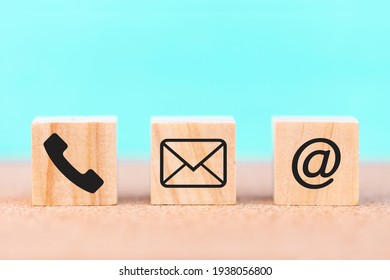 Wooden cubes with symbol telephone, email, address. contact us or e-mail marketing concept