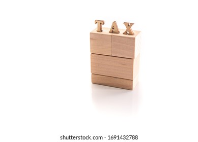 Wooden cubes with the text Tax isolated on white background with copy space.