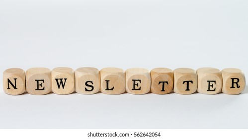 wooden cubes with the word newsletter
