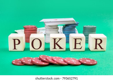"Wooden cubes with word ""POKER"", poker chips, deck of playing cards and money on a green background."