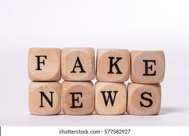 wooden cubes with the words fake news