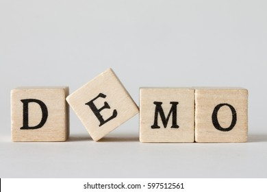 wooden cubes written as DEMO,Acronym for demonstration