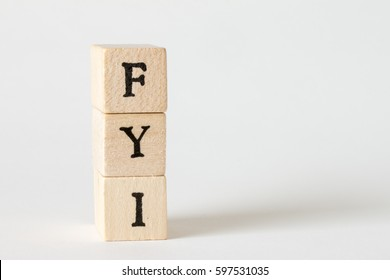 wooden cubes written as FYI,For Your Information