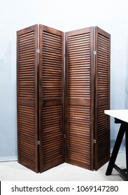 Wooden curtain of brown color blinds