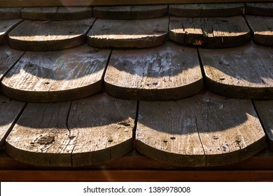 Wooden curved roof tiles in form of scales background