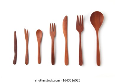 wooden cutlery sppons forks knife closeup isolated on white background