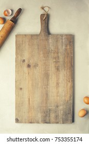 Wooden cutting board and baking imgredients. Top view, copyspace