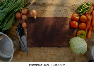 Wooden cutting board, full of vegetables, home made, simple food concept.