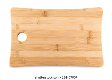 Wooden cutting board isolated over white background