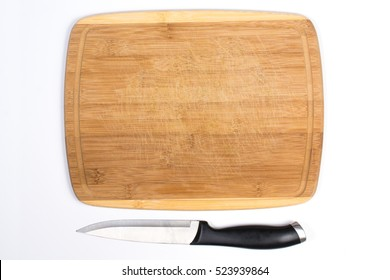 Wooden Cutting Board with Small Knife Beside Isolated on White