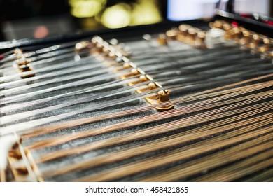 Wooden czech dulcimer traditional musical instrument. Selective focus.