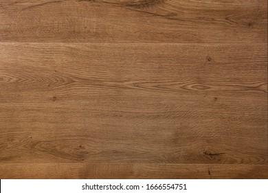 Wooden dark brown background. Top view