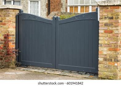 Wooden, dark gray garden gate.